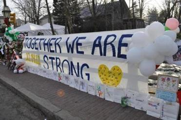 Bellingham resident Jeff Belanger took several photos of the spontaneous memorials around his hometown of Newtown that sprang up in late December. This banner was hung in the center of Sandy Hook, a village of Newtown.