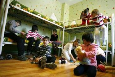 Orphan children play in their bedroom at an orphanage in the southern Russian city of Rostov-on-Don in December.