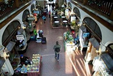Shoppers peruse stands at the Brookline Winter Farmer's Market in the Arcade Building.