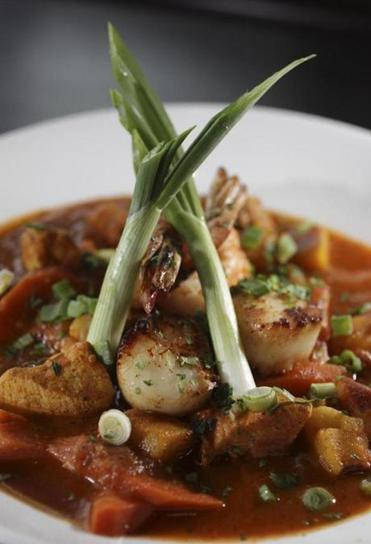 With its view overlooking Boston Harbor, 75 on Liberty Wharf offers up hearty meals such as seafood stew.