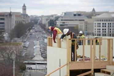 Construction workers on the inaugural platform, which will be the largest ever built and will hold 1,600 people.