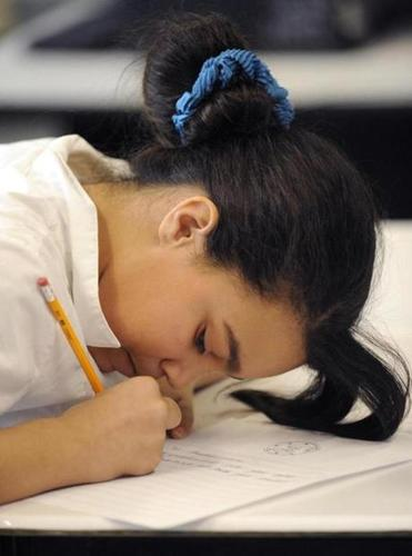 Malika Jusino, 10, uses an up close approach to her writing.