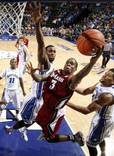 UMass guard Chaz Williams, who finished with 14 points and seven assists, drives on Saint Louis's Cory Remekun.