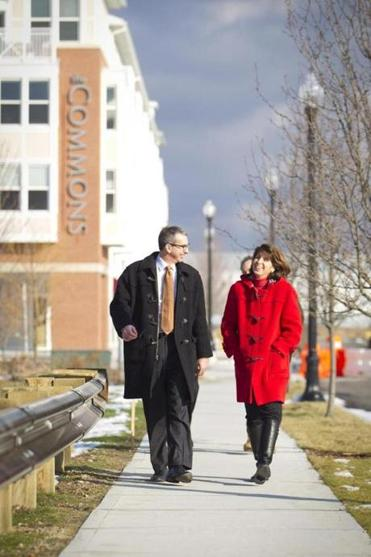 Paul Hickey, the director of development for LNR Property LLC and Tricia Bruno, right, the marketing director for LNR, walked down Trotter Road, which connects the residential areas of SouthField to the nearby South Weymouth Commuter Rail station.