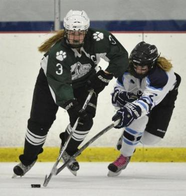 Canton center Meaghan McKenna skates with the puck past a defender during Saturday's decisive 7-2 win over Medfield.
