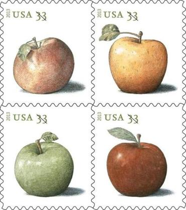 An artist's rendering provided by the US Postal Service shows , clockwise from top left, the Northern Spy, Golden Delicious, Baldwin, and Granny Smith apples.