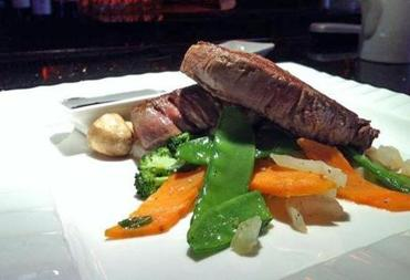 Kyoto Japanese Steakhouse at 242 Chauncy St. serves a filet mignon dish for $19.95. The 8-ounce grain-fed filet is grilled and is served with peapods, carrots, and a sweet tamarind sauce.