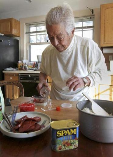 Susumu Ito made spam musubi in his home in Wellesley.