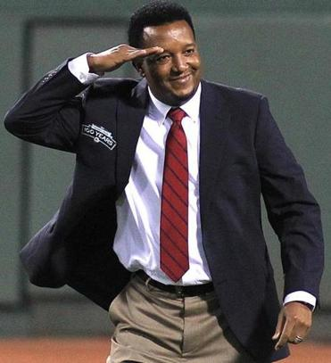 Pedro Martinez salutes a fan at Fenway in September.