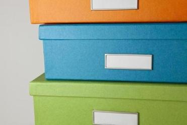 Low-cost storage bins can reduce clutter while adding visual interest.