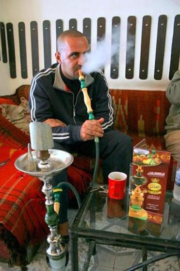 A man uses a hookah pipe in Baghdad. A Plymouth hookah lounge owner hopes to expand to Bridgewater.