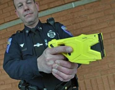 Officer Brian Smith demonstrates the TASER X2 weapon.