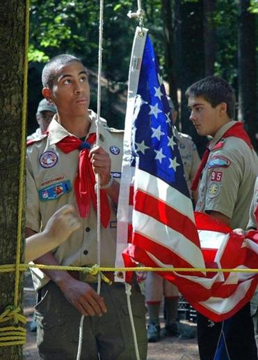 Cambridge Eagle Scout Tano Holmesson of Derrick Z. Jackson, raises the flag at a Boy Scouts event in 2006.