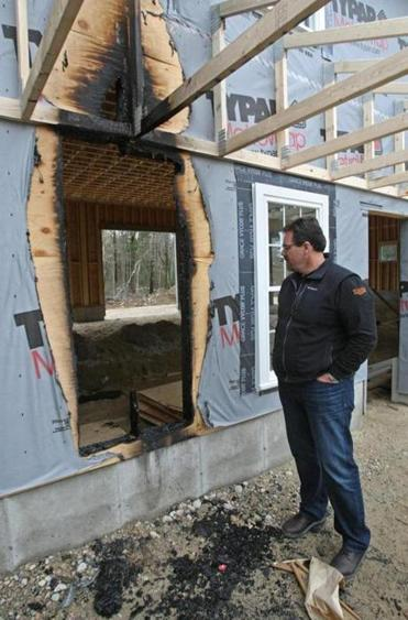 Robert Iafrate inspected the damage a fire caused to his building Thursday in West Bridgewater.