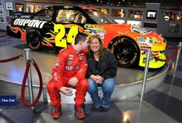 Kaz Grala, 14, of Westborough, and his mother, Karen, visit the NASCAR display at F1 Boston in Braintree, the scene of his first go-kart racing experiences at age 7.