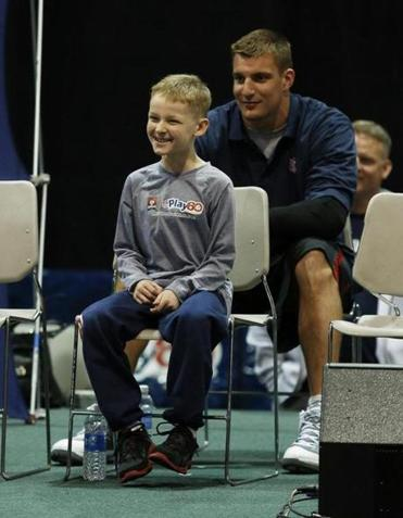 Rob Gronkowski looked on as Hunter Paulin, 10, was announced for his role in Super Bowl XLVII on Wednesday.