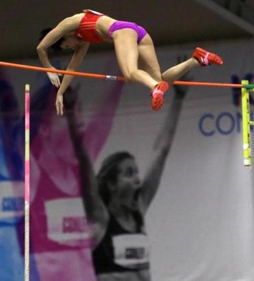 Jenn Suhr won the pole vault, but fell shy of setting an American indoor record.