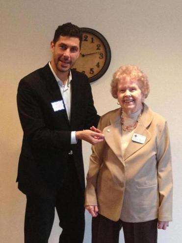 Jarrett Barrios presented Laurice Zwicker with a pin for her 30 years of employment with the American Red Cross.
