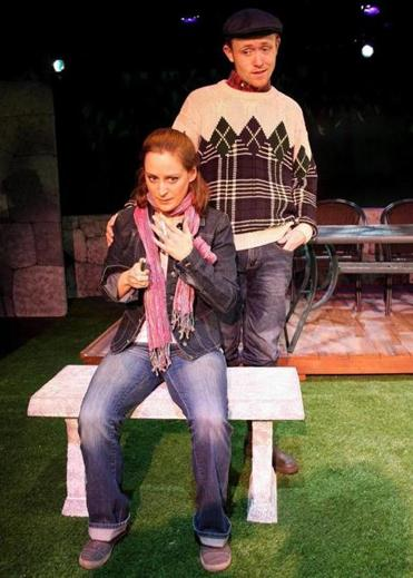 "Angela Smith plays Monica, the wife of a dying man, and Brooks Reeves plays the farmer for whom Monica has left her husband in Alan Ayckbourn's ""Life of Riley."""