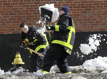 Boston firefighter recruits Tom Nee (left) and Pat McKenna shoveled out a hydrant on Columbus Avenue Tuesday. The city moved toward normalcy Tuesday, following the weekend snowstorm.