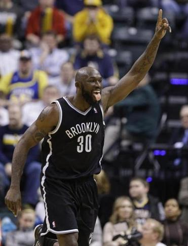 Reggie Evans of the Nets celebrates after tipping in a basket with 45 seconds left in overtime against the Pacers.