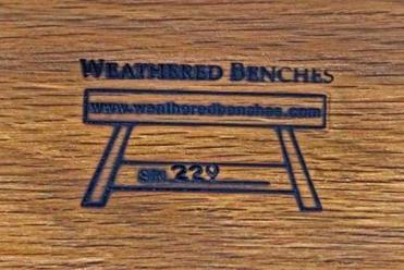 Each bench made of wood from reclaimed USS Constitution timbers dug up from the Charlestown Naval Yard is branded and numbered on the bottom.
