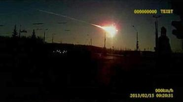 Ameteor streaked across the sky of Russia's Ural Mountains as shown from a dashboard camera on a vehicle traveling in the Chelyabinsk region.