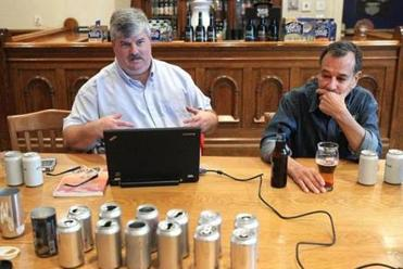 Professional beer taster Roy Desrochers (left) and Boston Beer Co. founder Jim Koch discussed the development of a can.