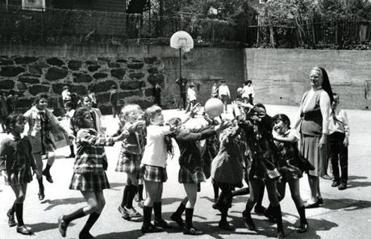 Sister Maria Laretta played ball with first-graders at St. Patrick's School Roxbury in 1972.