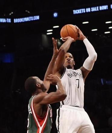 Brooklyn's Joe Johnson rises to the occasion, hitting the winning shot in OT.
