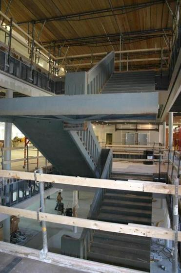 "The view from the second floor looking out onto the central ""floating"" staircase."