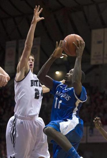 St. Louis's Mike McCall takes it right to Butler's big man Kellen Dunham.