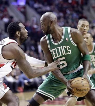Celtics forward Kevin Garnett looked for an opening against Trail Blazers center J.J. Hickson early in the game.