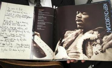 A Hendrix lyric book with a photo from that night's performance.