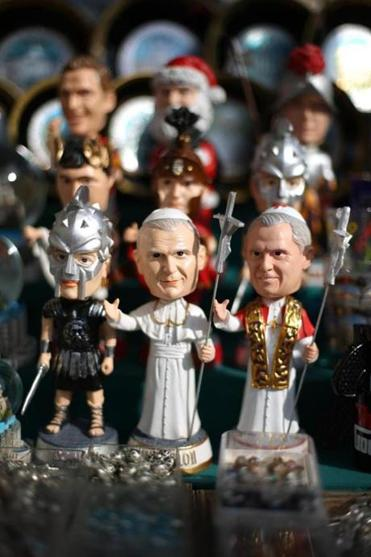 Toy figures depicting Pope John Paul II and Pope Benedict XVI were displayed for sale Sunday in Rome. Benedict will officially step down at 8 p.m. on Thursday.