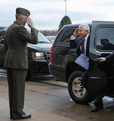 Chuck Hagel, saluting Marine Lieutenant General Tom Waldheuser, arrived at the Pentagon to be sworn-in as secretary.