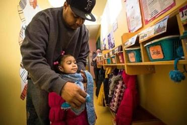Sean Joy of Boston helped his daughter Jayla, 3, put on a scarf before leaving a Head Start center in Boston last week.