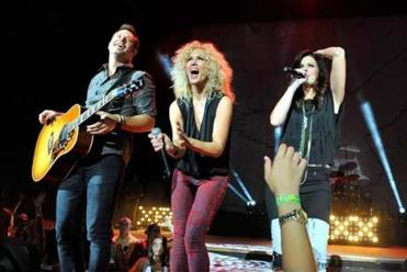 From left: Jimi Westbrook, Kimberly Schlapman and Karen Fairchild of Little Big Town perform in Laguna Hills, Calif.