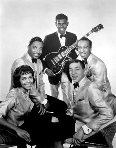 Bobby Rogers (behind his cousin Claudette) cowrote some classic Motown songs with Smokey Robinson (front, right). Other members of the Miracles were Marv Tarplin (back) and Ronnie White.