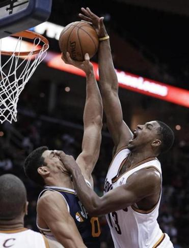 Tristan Thompson jumps toward the basket under pressure from Utah's Enes Kantor.