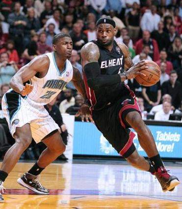 Miami Heat's LeBron James, right, drove against Orlando Magic's DeQuan Jones during the fourth quarter of an NBA basketball game in Miami on Wednesday, March 6, 2013.
