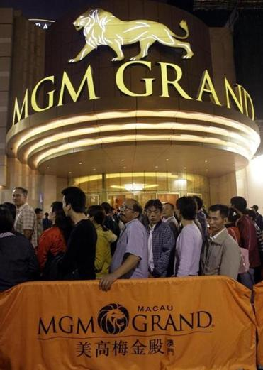 Patrons lined up at MGM's resort in Macau. The stock closed at 13.16 Friday.