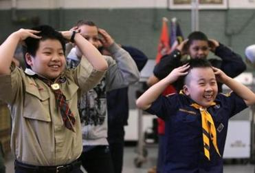 Scouts played a game in unison Friday. One of Scouting's biggest hits is the new rewards points system program.