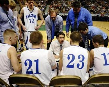 Danvers head basketball coach John Walsh, talks to his players in a timeout during the Div. 3 Boy's State Basketball Finals against Smith Academy.