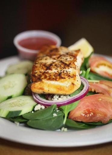Spinach salad with grilled salmon at Beat Da' Wrap Pizza & Grill in Waltham.