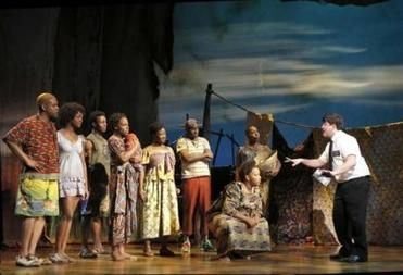 "A scene from the touring company production of ""The Book of Mormon."""