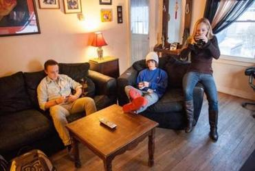 Keri-Ann Aubin, mother of teenagers Steven Ranney (left) and Kevin Ranney, struggles even with a Smith College degree.