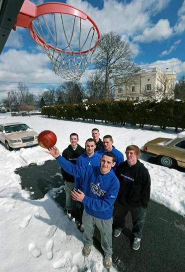 Danvers senior basketball teammates and neighbors (clockwise from front), Eric Martin, Nick McKenna, Evan Eldridge, Nick Bates, Duncan D'Hemecourt, and Jake Cawlina in McKenna's front yard.