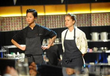 "This image released by Bravo shows chef contestants Kristen Kish, left, and Brooke Williamson in a scene from ""Top Chef: Seattle."" Kish and Williamson are finalists in the cooking competition series airing Wednesdays at 10 p.m. EST on Bravo. (AP Photo/Bravo, David Moir)"