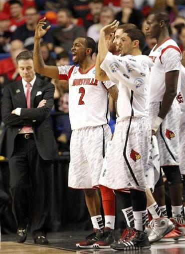 Louisville's Rick Pitino had to be happy with Russ Smith (2), who had eight steals, a team record in the tournament.